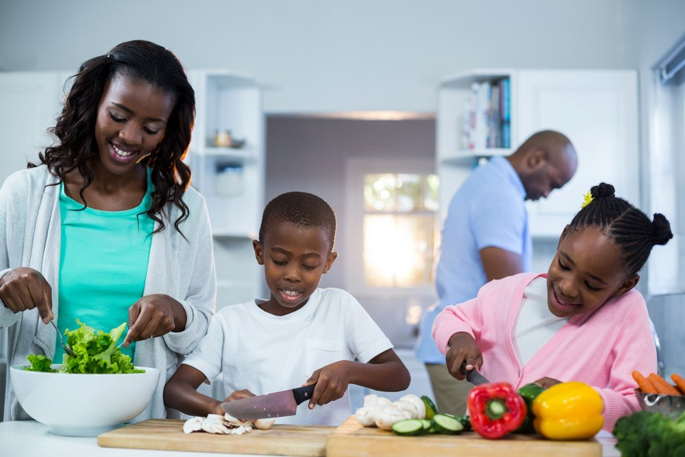 Happy family preparing food in kitchen